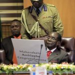 Reporters arrested over Mugabe health scare story