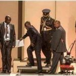 Watch:Aides Physically lift Mugabe as he Struggles to Light Up the  Independence flame