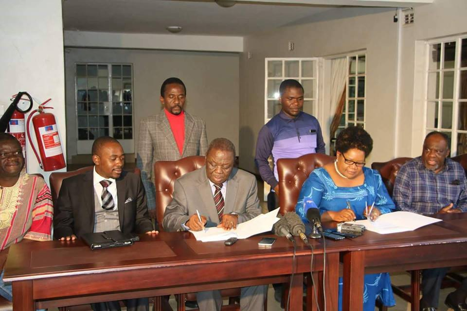 Zimbabwe opposition sign coalition agreement