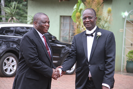 Professor Moyo (right) welcomes defence forces chief Constantine Chiwenga. '