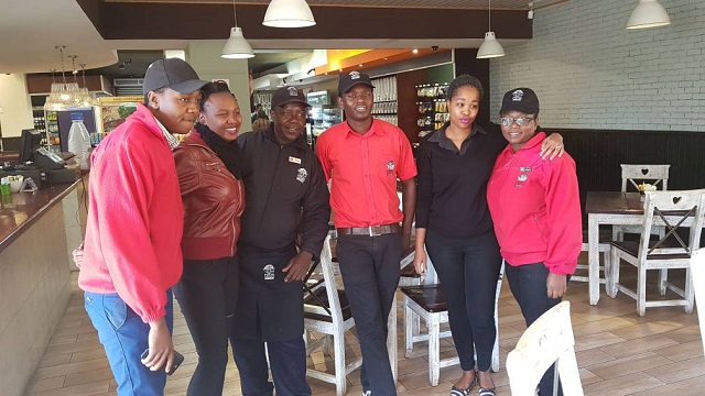 Trinity Sibanda (second left), Zodwa Wabantu's Byo 'twin' with Food Lover's Market staff