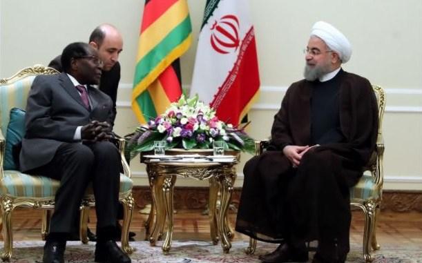 Zimbabwean President Robert Mugabe and Iranian President Hassan Rouhani