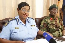 Zimbabwe Defence Forces Spokesperson Colonel Overson Mugwisi (right) with Zimbabwe Republic Police national spokesperson Senior Assistant Commissioner Charity Charamba (left) during a press conference on Police and Army personnel clashes in town. (Picture by John Manzongo)