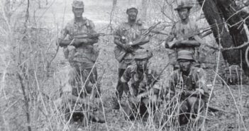 The elite troops of the Rhodesian SAS, known as C Squadron, pose carrying AK-47s in the dense thorn scrub of the Zambezi Valley. The unit operated in Rhodesia, now known as Zimbabwe, from 1968 to 1980, fighting nationalist groups that were trying to overthrow the white colonialist government of the time