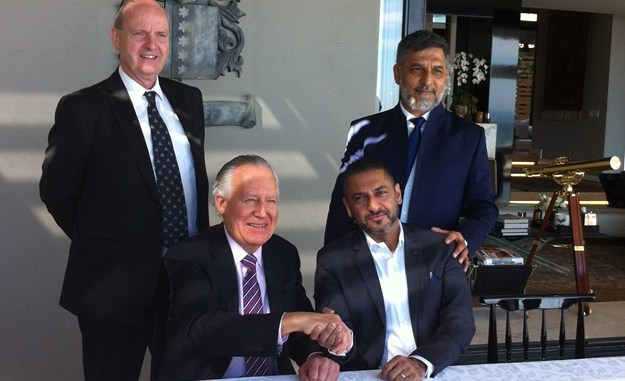 Joining hands to work together are Lord Peter Hain (front left), Zunaid Moti (front right), Paul O'Sullivan (back left) and Ashruf Kaka (CEO of the Moti Group). (Pic: Carin Smith)