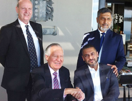 Joining hands to work together are Lord Peter Hain (front left), Zunaid Moti (front right), Paul O'Sullivan (back left) and Ashruf Kaka (CE of the Moti Group). (Pic: Carin Smith)