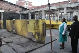 Harare Central Hospital director of operations Mr Peter Gwata and catering manager Mrs Lynett Nyamariva assess the damage caused by a fire