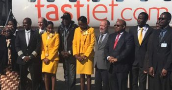 Maiden flight ... FastJet chairman Farai Mutamangira (fourth from right) poses for a picture at the Joshua Mqabuko Nkomo International Airport with crew and music star Oliver Mtukudzi after the maiden flight