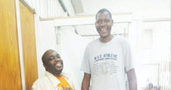 Simbarashe Mhukahuru, probably Zimbabwe's tallest man at 2,11m turned heads when he walked through the streets of Masvingo on Tuesday. Above The Mirror editor Nkulumani Mlambo looks like a midget when he stands besides Mhukahuru whose head is above the door way.
