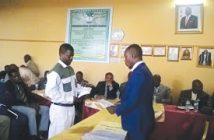 Ishmael Maukazuva being sworn in by Acting Chikomba RDC CEO Bullen Chiwara.