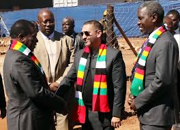 President Mnangagwa chats with African Chrome Fields CEO Mr Zunaid Moti