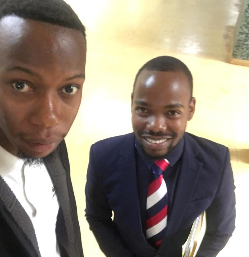 Free to go ... Tawona Shadaya (left) tweeted a selfie of himself with his lawyer after his trial collapsed on Tuesday