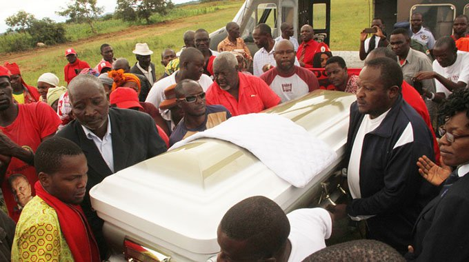Pallbearers carry the casket bearing the body of former Prime Minister and MDC-T leader Mr Morgan Tsvangirai at Makanda Primary School, Humanikwa Village, in Buhera yesterday. — Picture by Tawanda Mudimu