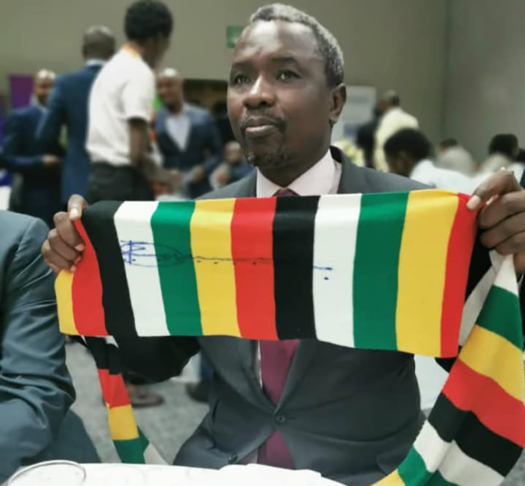 Expensive purchase ... Kudakwashe Tagwirei with the scarf after winning auction