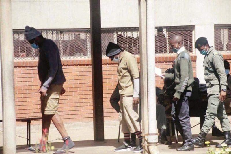 Cruel ... Journalist Hopewell Chin'ono and opposition politician Jacob Ngarivhume seenin leg irons at Chikurubi Maximum Security Prison