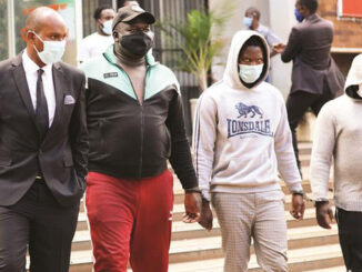 DJ Fantan, real name Arnold Kamudyariwa (second from left) and Levels, real name Tafadzwa Kadzimwe, (second from right) appear at the Harare Magistrates' Courts yesterday. — Picture: Lee Maidza