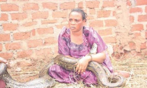 woman-zimbabwe-breastfeeds-snake