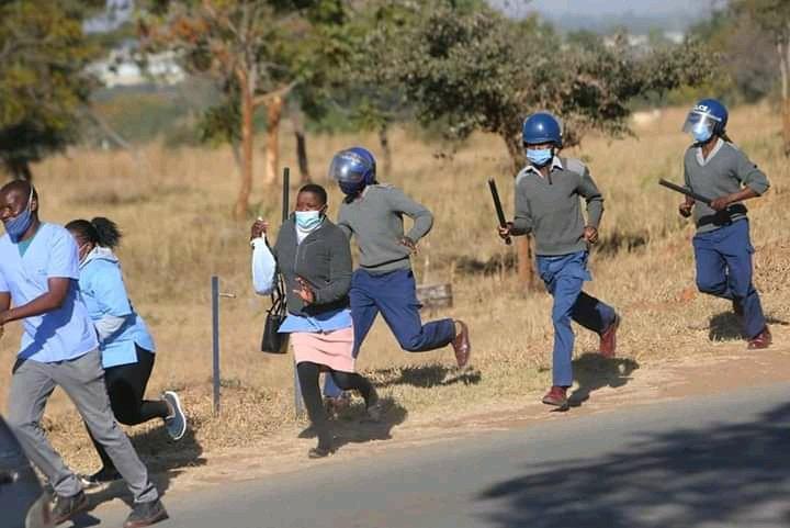Nurses-Flee-From-Baton-wielding-police